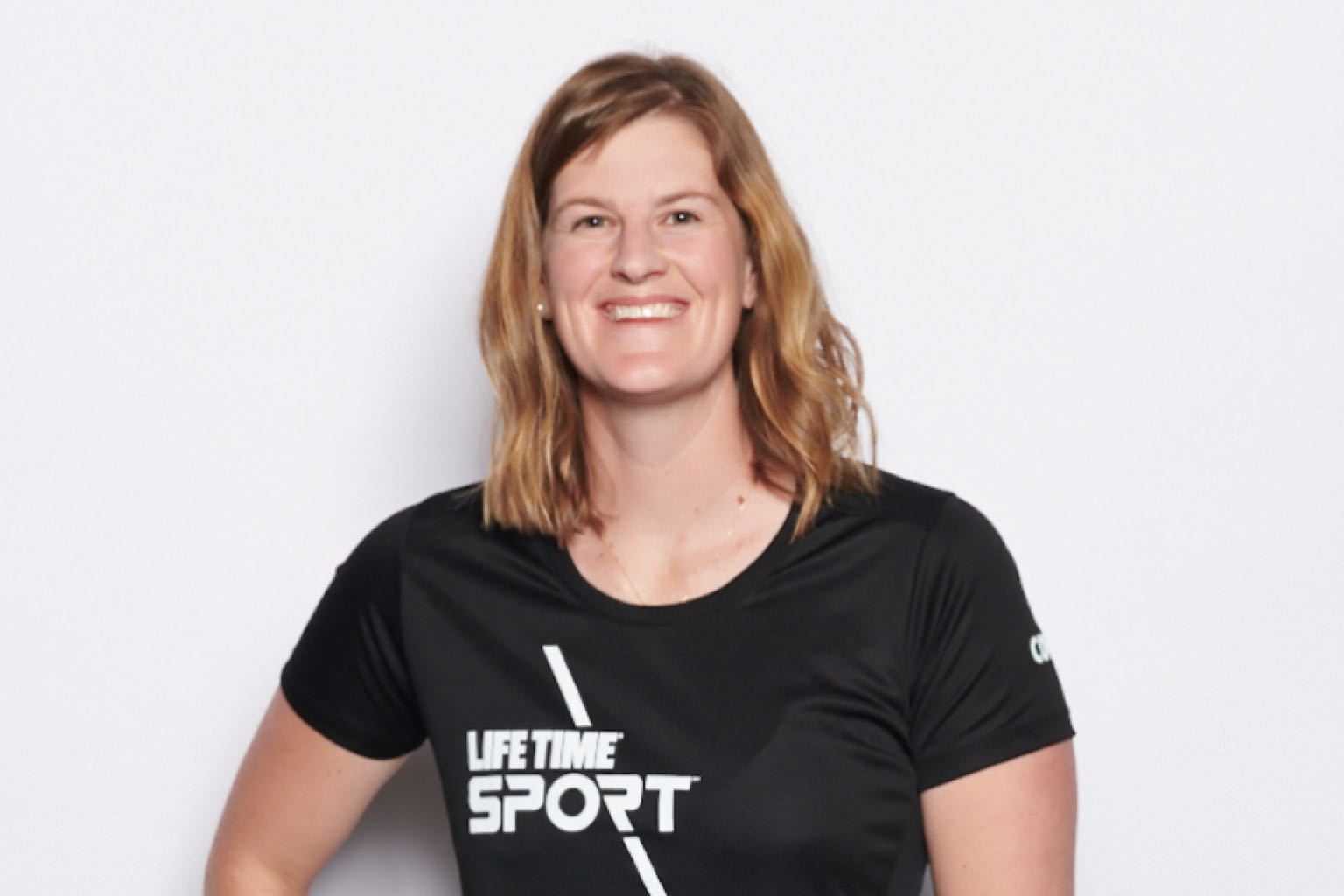 A head shot of Sara C, a summer clinics coach at the Life Time Sport at Winter Park
